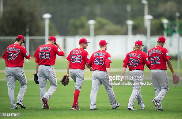 Joe Kelly of the Boston Red Sox center walks off the field with the group of pitchers on February 23 2016 at Fenway South in Fort Myers Florida