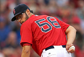 Joe Kelly of the Boston Red Sox check the runner at first during the first inning during a game with the Toronto Blue Jays at Fenway Park on June 12...