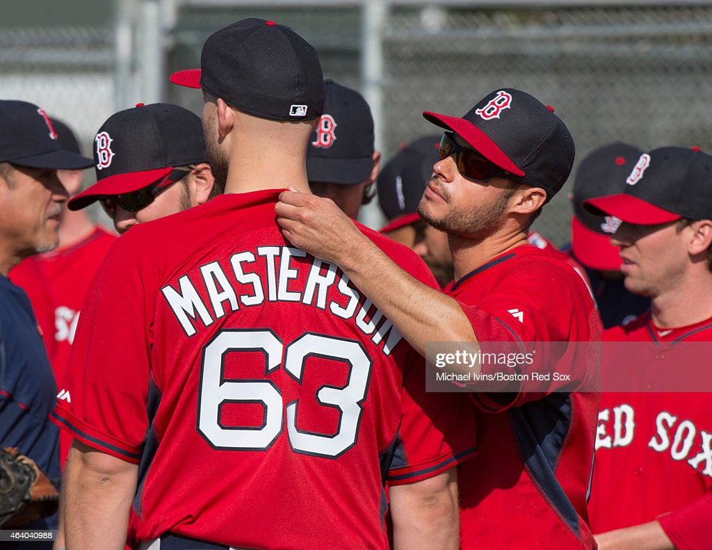 Joe Kelly of the Boston Red Sox checks the tag on teammate Justin Masterston's jersey during a Spring Training workout at Fenway South on February 21, 2015 in Fort Myers, Florida.