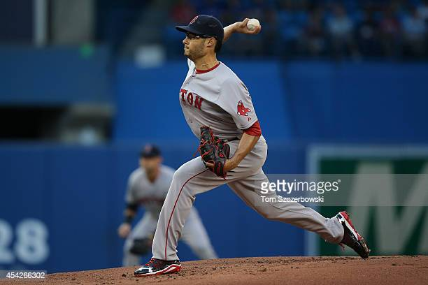 Joe Kelly of the Boston Red Sox delivers a pitch in the first inning during MLB game action against the Toronto Blue Jays on August 27 2014 at Rogers...