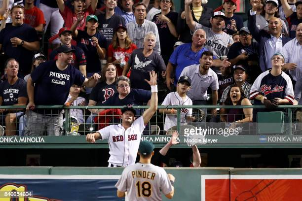 Joe Kelly of the Boston Red Sox jumps from the bullpen to try and catch a home run hit by Jackie Bradley Jr #19 during the fifth inning against the...