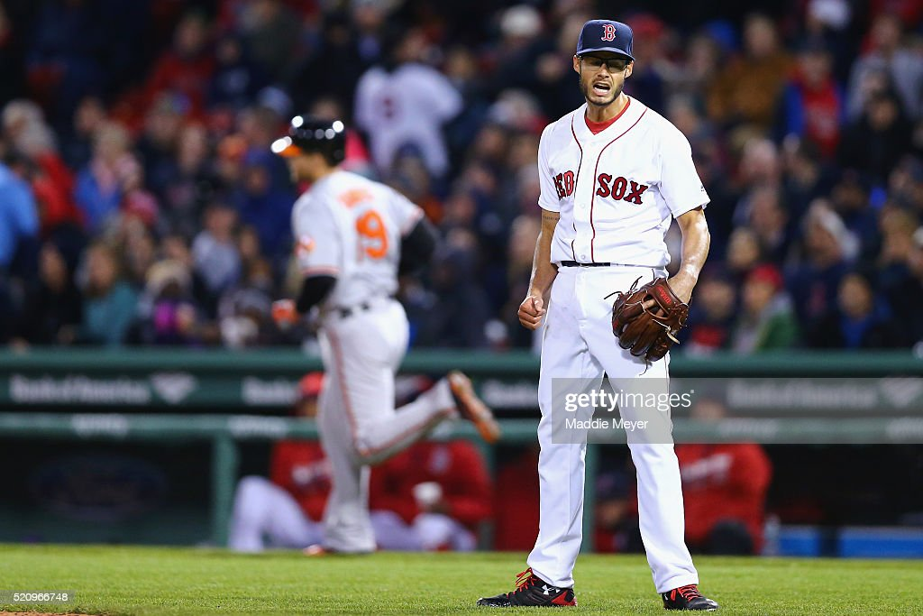 Joe Kelly #56 of the Boston Red Sox reacts after Chris Davis #19 of the Baltimore Orioles hit a two run homer during the third inning at Fenway Park on April 13, 2016 in Boston, Massachusetts.