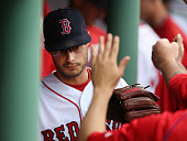 Joe Kelly of the Boston Red Sox reacts with teammates as he exits the game during the seventh inning of a game against the Cleveland Indians on May...