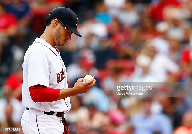 Joe Kelly of the Boston Red Sox takes a moment in between pitches against the Houston Astros during the game at Fenway Park on August 17 2014 in...