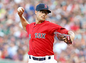 Joe Kelly of the Boston Red Sox throws in the first inning agains the Seattle Mariners at Fenway Park on August 14 2015 in Boston Massachusetts...