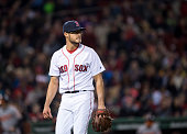 Joe Kelly of the Boston Red Sox walks off the mound against the Baltimore Orioles in the second inning on April 13 2016 at Fenway Park in Boston...