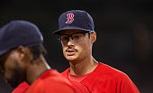 Joe Kelly of the Boston Red Sox walks to the dugout after the fifth inning against the Philadelphia Phillies at Fenway Park on September 4 2015 in...