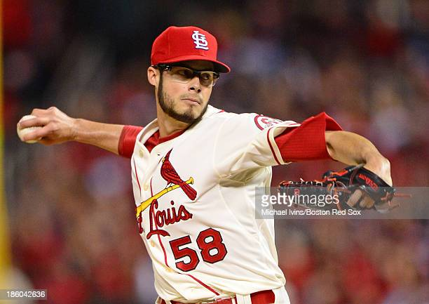 Joe Kelly of the St Louis Cardinals pitches against the Boston Red Sox in the first inning of Game Three of the World Series on October 26 2013 at...