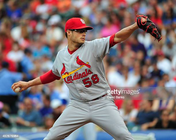 Joe Kelly of the St Louis Cardinals pitches against the Chicago Cubs during the first inning on July 25 2014 at Wrigley Field in Chicago Illinois