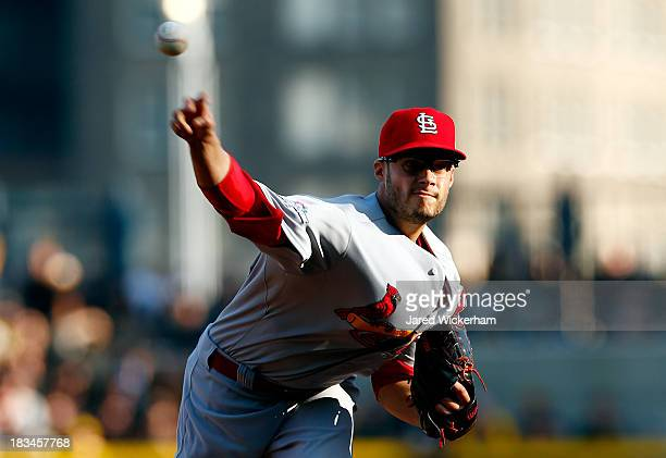 Joe Kelly of the St Louis Cardinals pitches against the Pittsburgh Pirates during Game Three of the National League Division Series at PNC Park on...