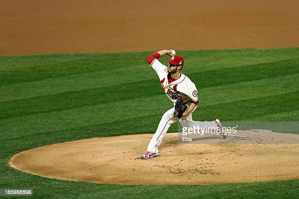 Joe Kelly of the St Louis Cardinals pitches in the first inning against the Boston Red Sox during Game Three of the 2013 World Series at Busch...