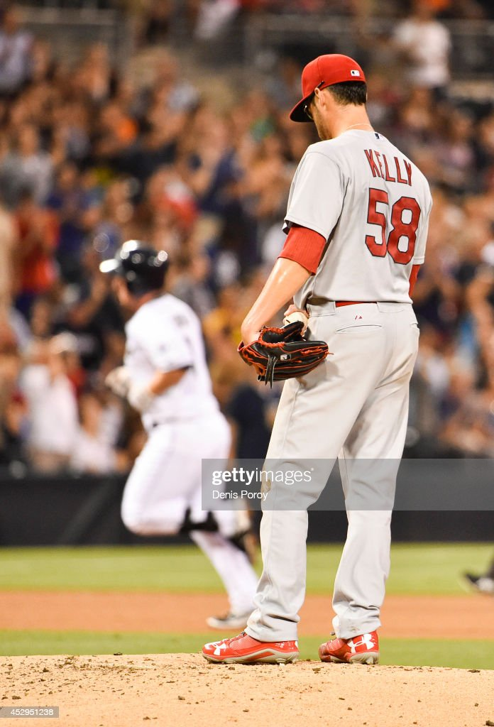 Joe Kelly #58 of the St. Louis Cardinals stands on the mound as Jedd Gyorko #9 of the San Diego Padres rounds the base after hitting a solo home run during the fourth inning of a baseball game at Petco Park July 30, 2014 in San Diego, California.