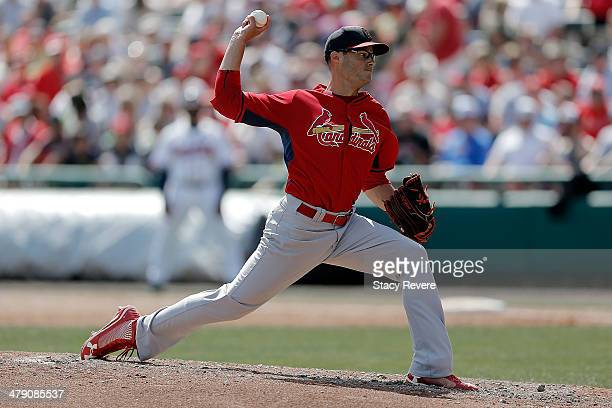 Joe Kelly of the St Louis Cardinals throws a pitch in the third inning of a game against the Atlanta Braves at Champion Stadium on March 15 2014 in...