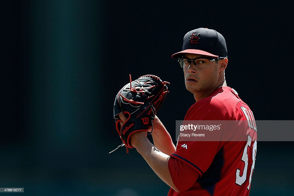 Joe Kelly #58 of the St. Louis Cardinals throws a pitch prior to a game against the Atlanta Braves at Champion Stadium on March 15, 2014 in Lake Buena Vista, Florida.