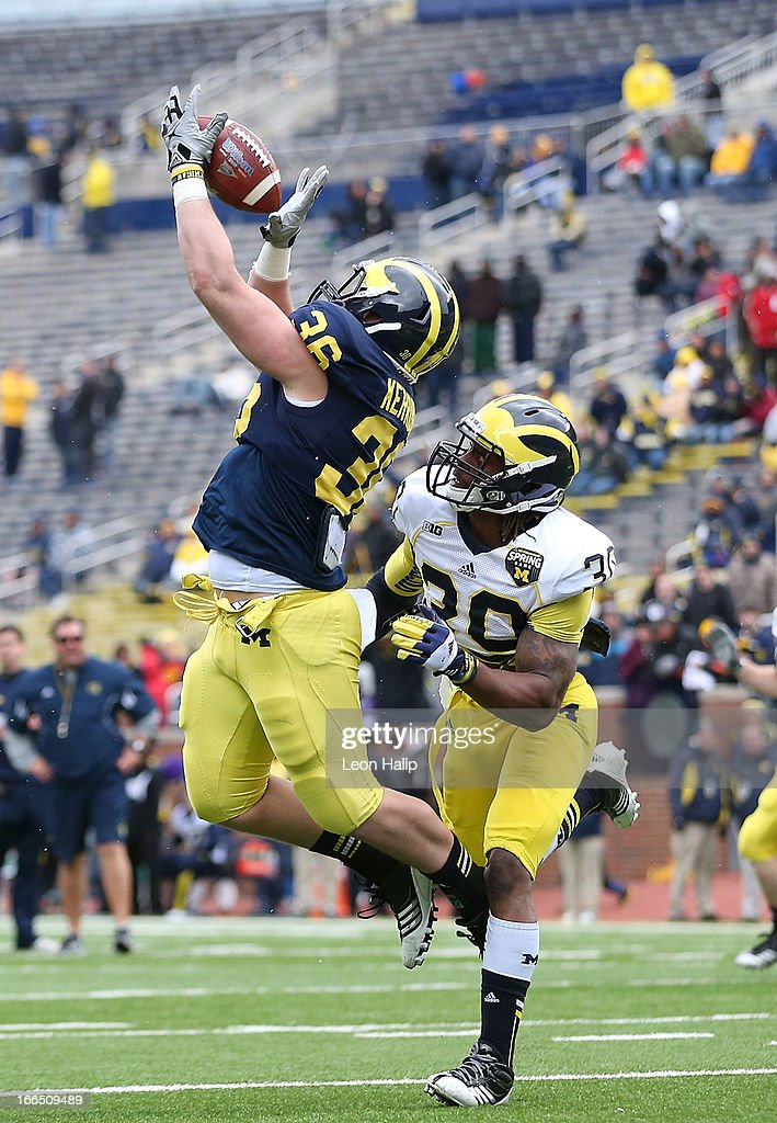 Joe Kerridge #36 attempts to make the catch as Thomas Gordon #30 defends during the Michigan Spring game at Michigan Stadium on April 13, 2013 in Ann Arbor, Michigan.