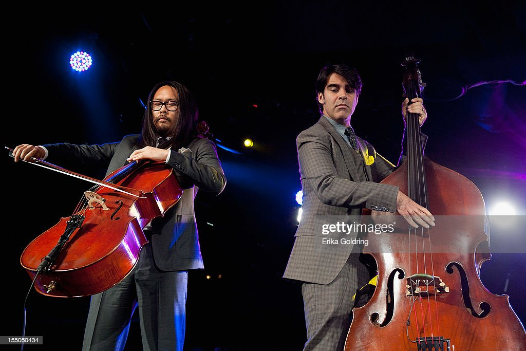 Joe Kwon and Bob Crawford of The Avett Brothers perform at the 60th annual BMI Country awards at BMI on October 30, 2012 in Nashville, Tennessee.