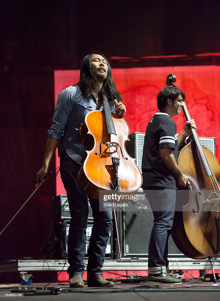 Joe Kwon (L) and Bob Crawford of The Avett Brothers perform during the 2012 Voodoo Experience at City Park on October 26, 2012 in New Orleans, Louisiana.