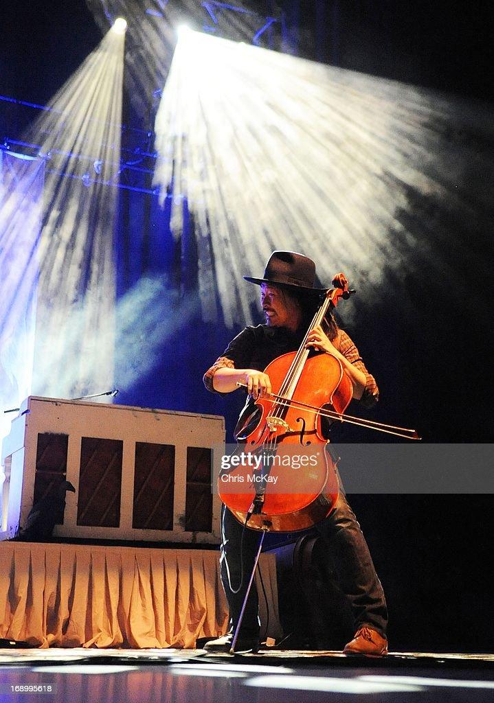 Joe Kwon of Avett Brothers performs at Verizon Wireless Amphitheater on May 17, 2013 in Alpharetta, Georgia.