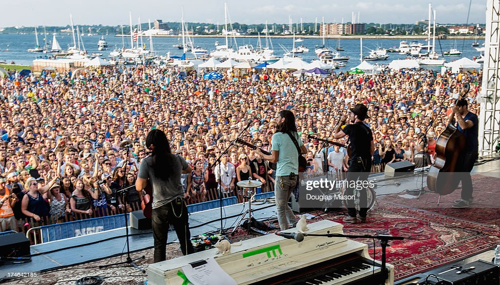 Joe Kwon, Seth Avett, Scott Avett and Bob Crawford of the Avett Brothers perform during the 2013 Newport Folk Festival at Fort Adams State Park on July 27, 2013 in Newport, Rhode Island.