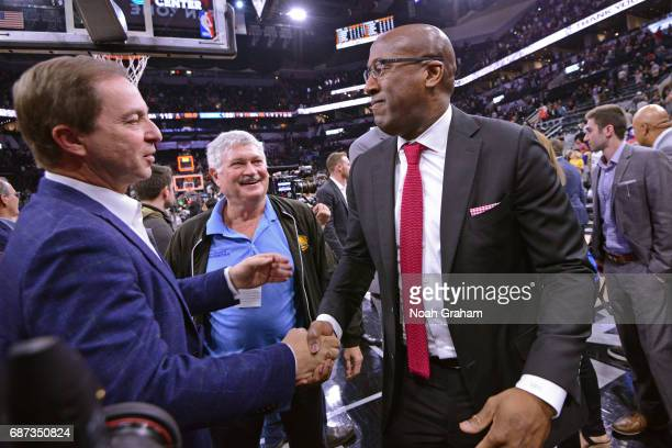 Joe Lacob and Mike Brown of the Golden State Warriors hug after winning Game Four of the Western Conference Finals against the San Antonio Spurs...