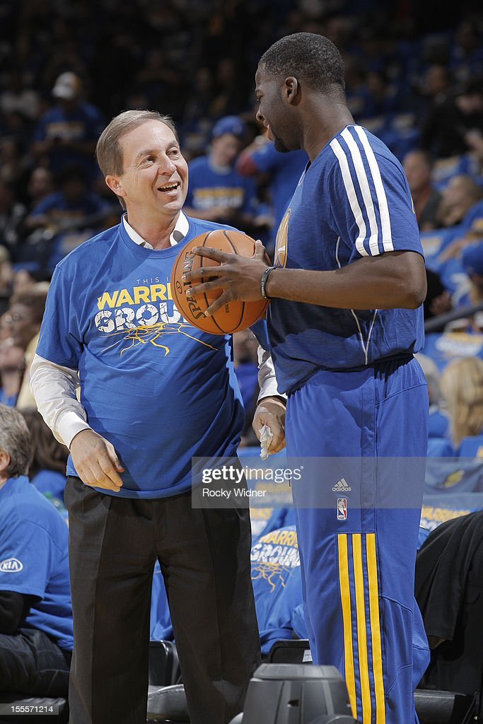 <a gi-track='captionPersonalityLinkClicked' href=/galleries/search?phrase=Joe+Lacob&family=editorial&specificpeople=7346074 ng-click='$event.stopPropagation()'>Joe Lacob</a> talks with <a gi-track='captionPersonalityLinkClicked' href=/galleries/search?phrase=Draymond+Green&family=editorial&specificpeople=5628054 ng-click='$event.stopPropagation()'>Draymond Green</a> #23 of the Golden State Warriors before a game against the Memphis Grizzlies on November 2, 2012 at Oracle Arena in Oakland, California.