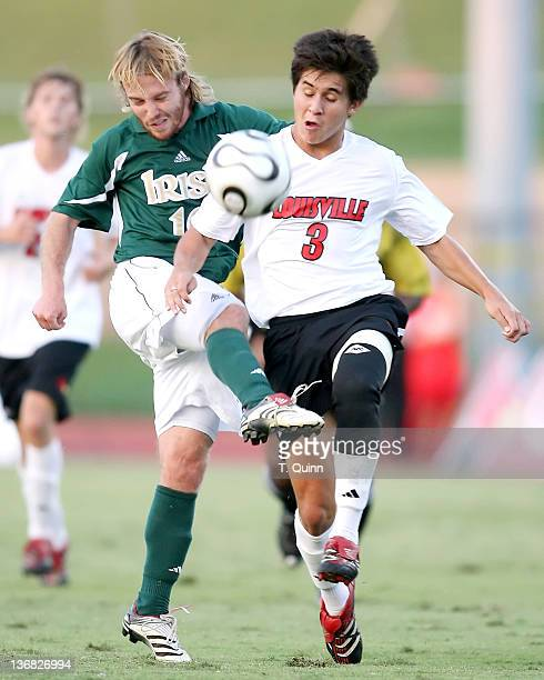 Joe Lapira of Notre Dame blasts a shot past Othaniel Yanez #12 Notre Dame came into town and spoilt the Louisville Cardinals home opener winning 20...