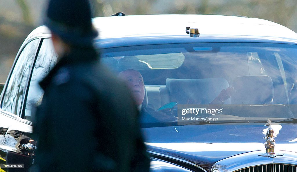 Joe Last, Queen Elizabeth II's chauffeur, raises his hands in the air as he has trouble starting Queen Elizabeth II's Bentley car as she leaves St. Mary Magdalene Church, Sandringham after attending Sunday service along with Prince Philip, Duke of Edinburgh and Lady Helen Taylor on January 13, 2012 near King's Lynn, England.