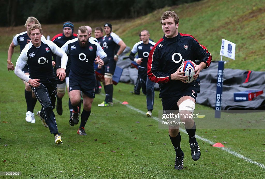 Joe Launchbury breaks with the ball during the England training session at Pennyhill Park on January 29, 2013 in Bagshot, England.
