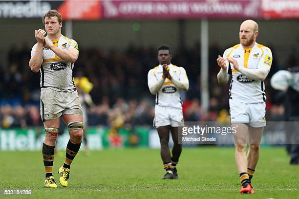 Joe Launchbury Christian Wade and Joe Simpson of Wasps applaud their supporters after their sides 2334 defeat during the Aviva Premiership semi final...