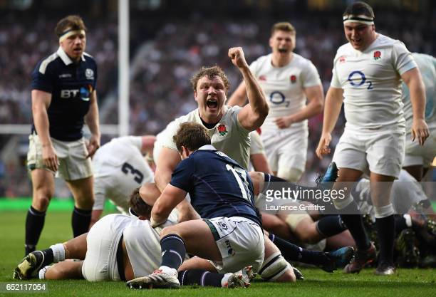 Joe Launchbury of England celebrates his sides fith try during the RBS Six Nations match between England and Scotland at Twickenham Stadium on March...