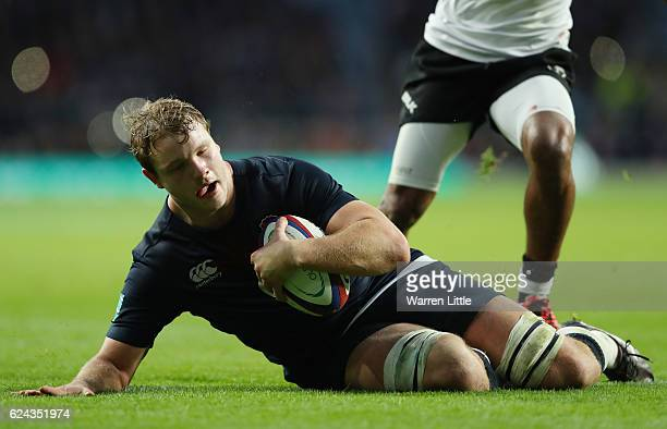 Joe Launchbury of England dives to score his team's ninth try during the Old Mutual Wealth series match between England and Fiji at Twickenham...