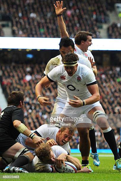 Joe Launchbury of England goes over to score a try underneath Captain Chris Robshaw of England during the QBE International match between England and...