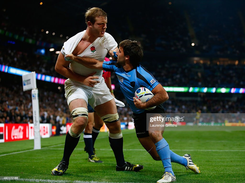 Joe Launchbury of England is pulled by Alejo Duran of Uruguay during the 2015 Rugby World Cup Pool A match between England and Uruguay at Manchester City Stadium on October 10, 2015 in Manchester, United Kingdom.