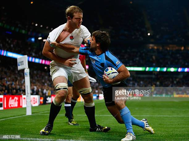 Joe Launchbury of England is pulled by Alejo Duran of Uruguay during the 2015 Rugby World Cup Pool A match between England and Uruguay at Manchester...