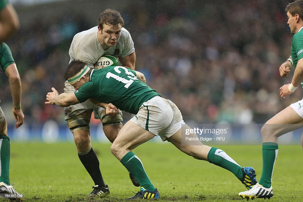 Joe Launchbury of England is tackled by Brian O'Driscoll of Ireland during the RBS Six Nations match between Ireland and England at Aviva Stadium on February 10, 2013 in Dublin, Ireland.