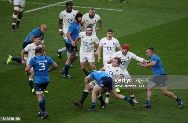 Joe Launchbury of England is tackled by Giorgio Bronzini of Italy during the RBS Six Nations match between England and Italy at Twickenham Stadium on...