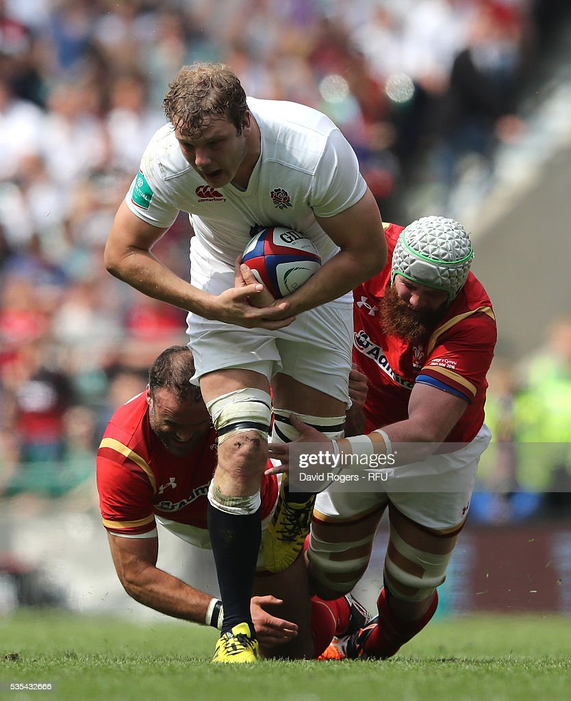 <a gi-track='captionPersonalityLinkClicked' href=/galleries/search?phrase=Joe+Launchbury&family=editorial&specificpeople=7440712 ng-click='$event.stopPropagation()'>Joe Launchbury</a> of England is tackled by Jake Ball (R) and <a gi-track='captionPersonalityLinkClicked' href=/galleries/search?phrase=Jamie+Roberts&family=editorial&specificpeople=3530992 ng-click='$event.stopPropagation()'>Jamie Roberts</a> during the England v Wales International match at Twickenham Stadium on May 29, 2016 in London, England.