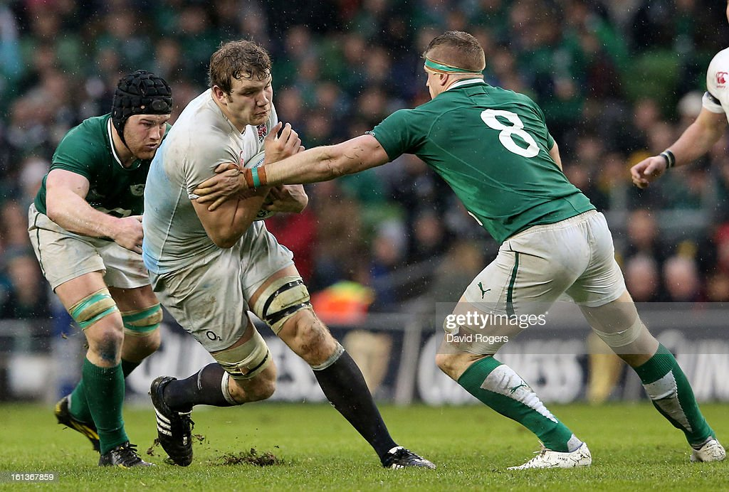 Joe Launchbury of England is tackled by Sean O'Brien and Jamie Heaslip of Ireland during the RBS Six Nations match between Ireland and England at Aviva Stadium on February 10, 2013 in Dublin, Ireland.