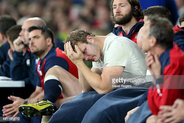 Joe Launchbury of England looks holds his head in his hands on the bench during the 2015 Rugby World Cup Pool A match between England and Australia...