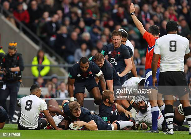 Joe Launchbury of England scores his team's fifth try during the Old Mutual Wealth series match between England and Fiji at Twickenham Stadium on...