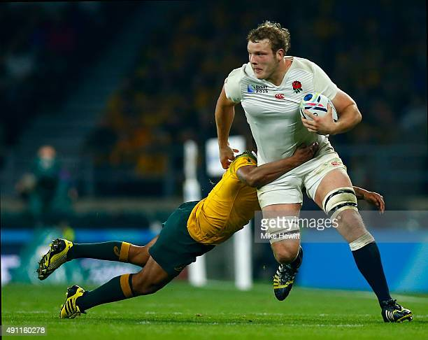 Joe Launchbury of England tackled by Will Genia of Australia during the 2015 Rugby World Cup Pool A match between England and Australia at Twickenham...