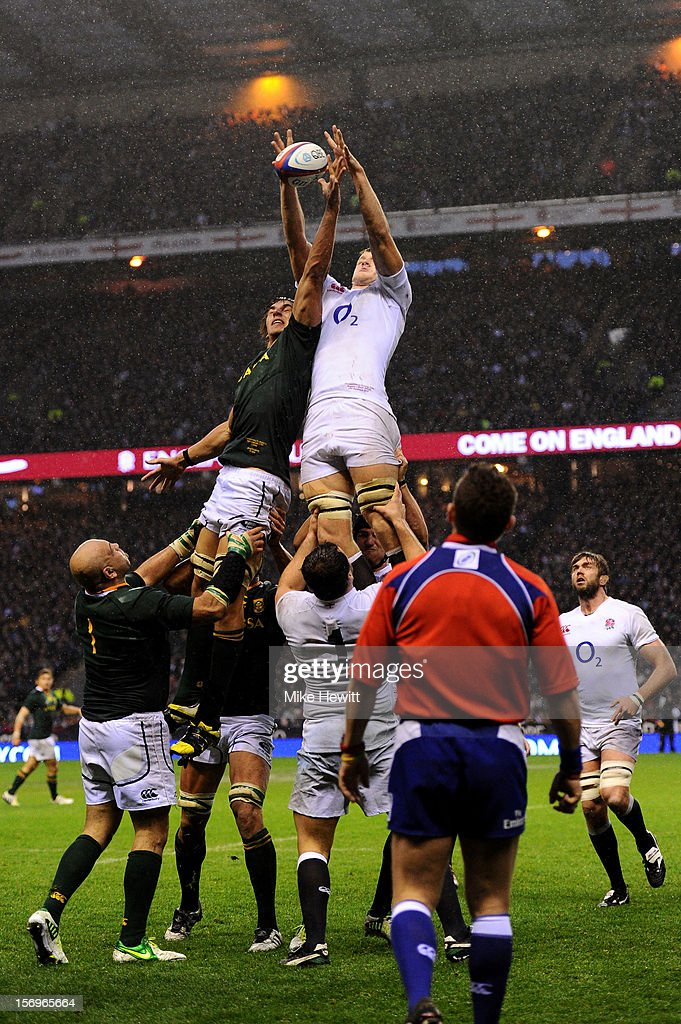 Joe Launchbury of England wins lineout ball under pressure from Eben Etzebeth of South Africa during the QBE International match between England and South Africa at Twickenham Stadium on November 24, 2012 in London, England.