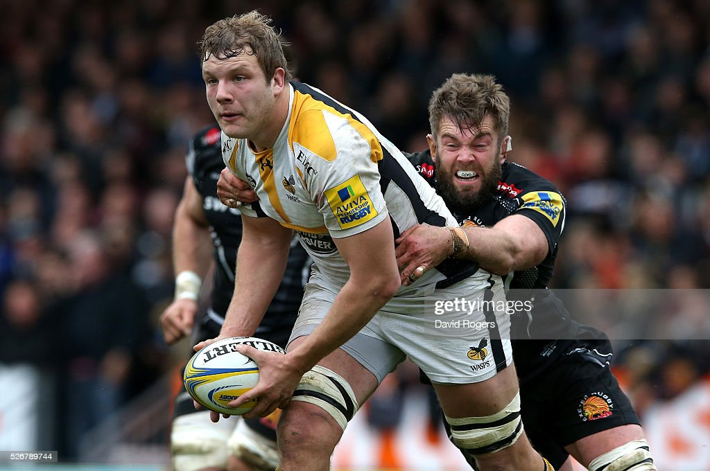<a gi-track='captionPersonalityLinkClicked' href=/galleries/search?phrase=Joe+Launchbury&family=editorial&specificpeople=7440712 ng-click='$event.stopPropagation()'>Joe Launchbury</a> of Wasps is held by <a gi-track='captionPersonalityLinkClicked' href=/galleries/search?phrase=Geoff+Parling&family=editorial&specificpeople=820816 ng-click='$event.stopPropagation()'>Geoff Parling</a> dduring the Aviva Premiership match between Exeter Chiefs and Wasps at Sandy Park on May 1, 2016 in Exeter, England.