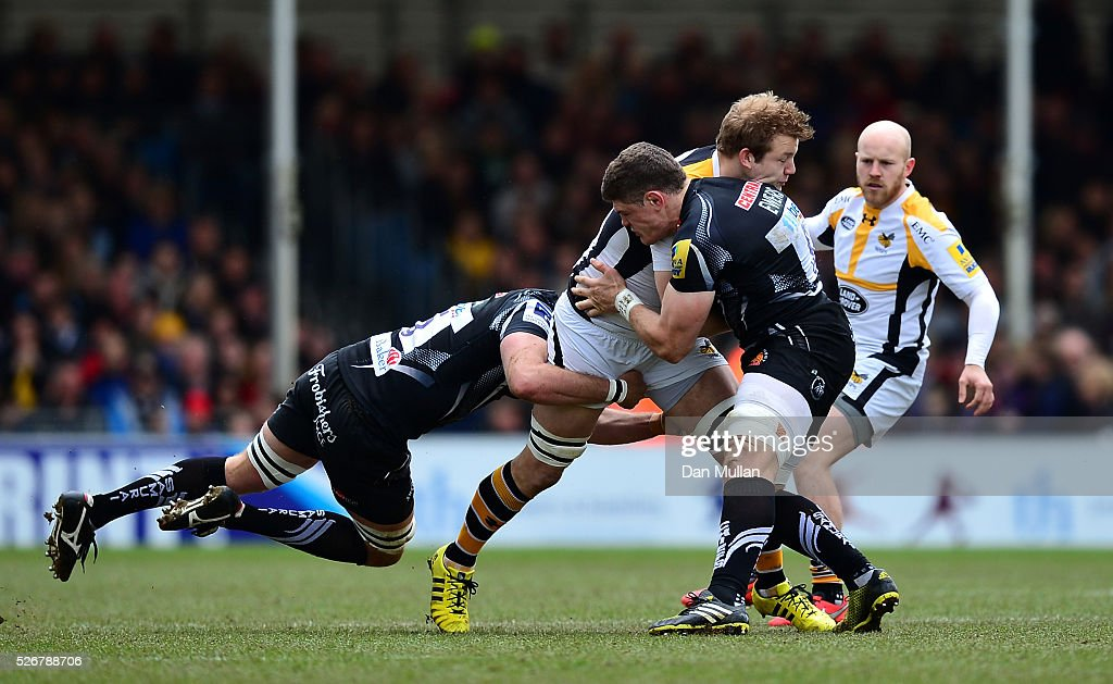 <a gi-track='captionPersonalityLinkClicked' href=/galleries/search?phrase=Joe+Launchbury&family=editorial&specificpeople=7440712 ng-click='$event.stopPropagation()'>Joe Launchbury</a> of Wasps is tackled by Don Armand and Dave Ewers of Exeter Chiefs during the Aviva Premiership match between Exeter Chiefs and Wasps at Sandy Park on May 01, 2016 in Exeter, England.