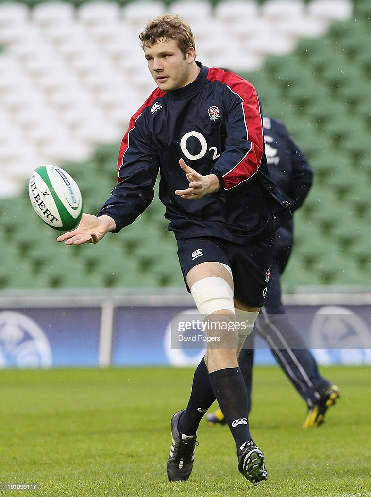 <a gi-track='captionPersonalityLinkClicked' href=/galleries/search?phrase=Joe+Launchbury&family=editorial&specificpeople=7440712 ng-click='$event.stopPropagation()'>Joe Launchbury</a> passes the ball during the England captain's run at the Aviva Stadium on February 9, 2013 in Dublin, Ireland.