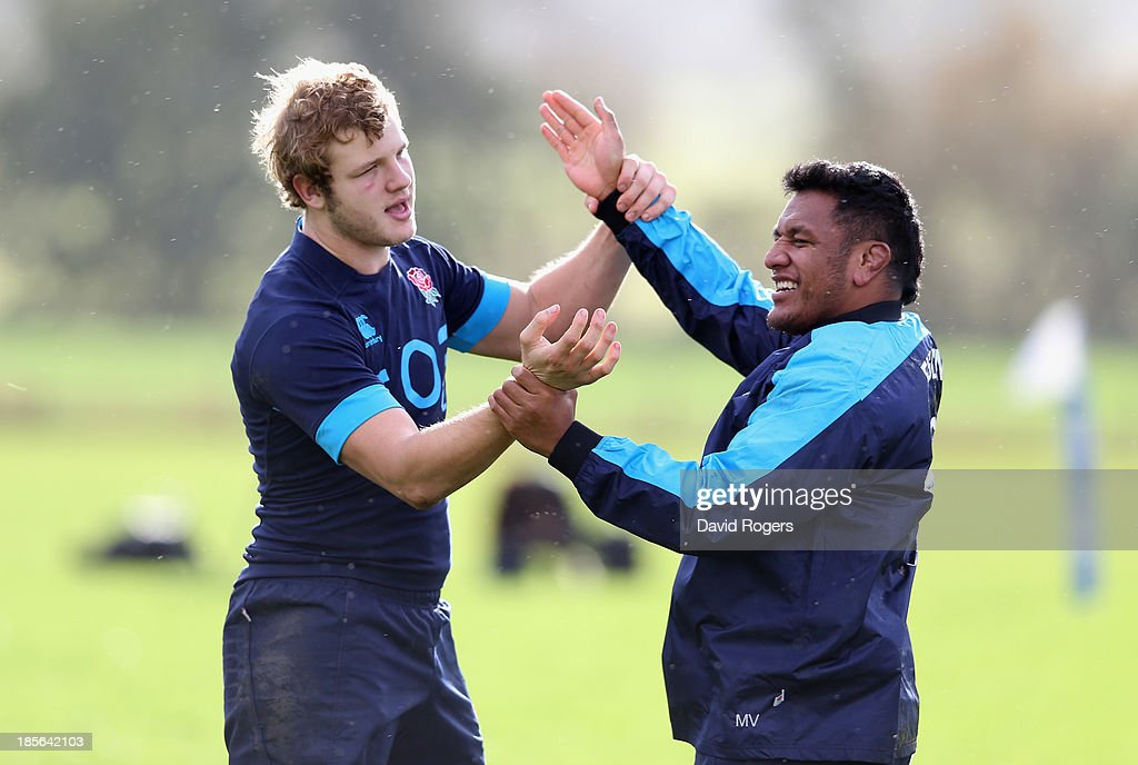 <a gi-track='captionPersonalityLinkClicked' href=/galleries/search?phrase=Joe+Launchbury&family=editorial&specificpeople=7440712 ng-click='$event.stopPropagation()'>Joe Launchbury</a> (L) tustles with team mate <a gi-track='captionPersonalityLinkClicked' href=/galleries/search?phrase=Mako+Vunipola&family=editorial&specificpeople=4948128 ng-click='$event.stopPropagation()'>Mako Vunipola</a> during the England training session held at West Park Leeds Rugby Club on October 23, 2013 in Leeds, England.