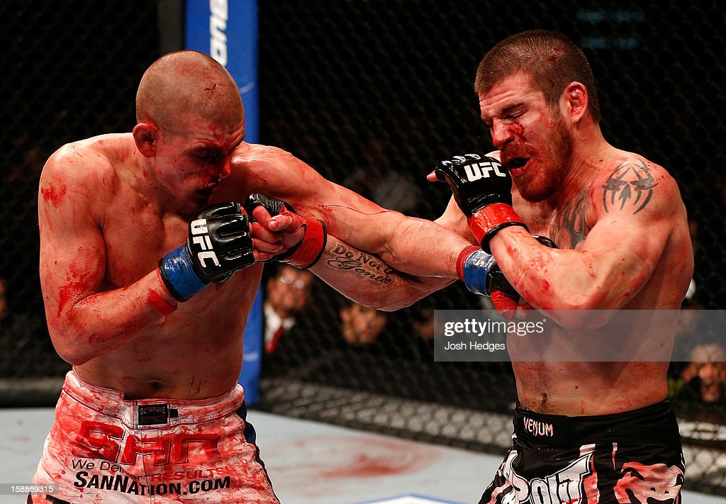 Joe Lauzon and Jim Miller trade punches during their lightweight fight at UFC 155 on December 29, 2012 at MGM Grand Garden Arena in Las Vegas, Nevada.