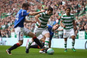 Joe Ledley of Celtic attempts to move past Andrew Little of Rangers during the Clydesdale Bank Premier League match between Celtic and Rangers at...