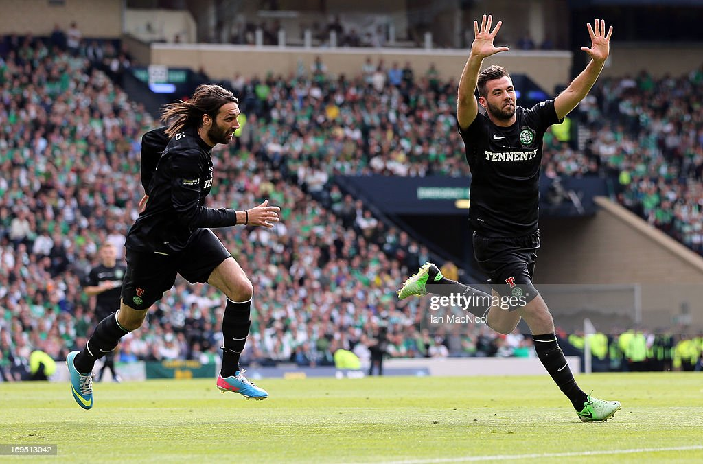 <a gi-track='captionPersonalityLinkClicked' href=/galleries/search?phrase=Joe+Ledley&family=editorial&specificpeople=687410 ng-click='$event.stopPropagation()'>Joe Ledley</a> (R) of Celtic celebrates with team-mate <a gi-track='captionPersonalityLinkClicked' href=/galleries/search?phrase=Georgios+Samaras&family=editorial&specificpeople=616608 ng-click='$event.stopPropagation()'>Georgios Samaras</a> after scoring their team's third goal during the William Hill Scottish Cup Final match between Celtic and Hibernian at Hampden Stadium on May 26, 2013 in Glasgow, Scotland.