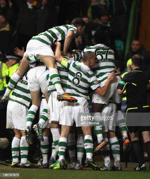 Joe Ledley of Celtic is surrounded by team mates after scoring during the Clydesdale Bank Premier League match between Celtic and Rangers at Celtic...